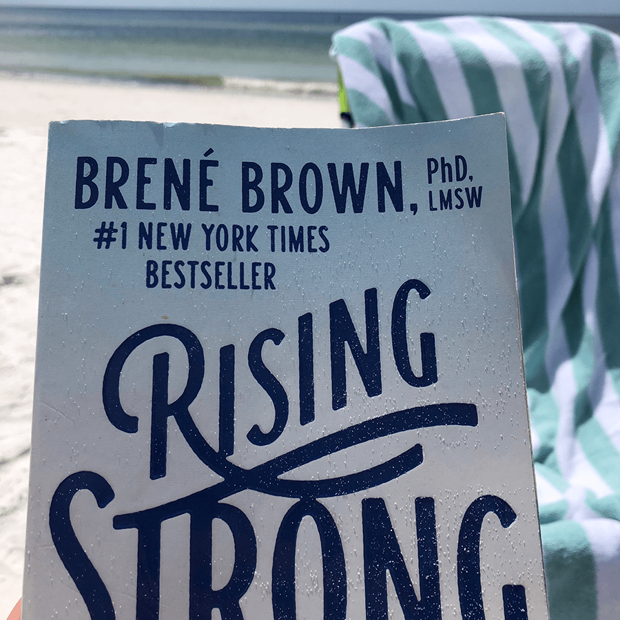 Cover of Rising String, by Brene Brown, on beach