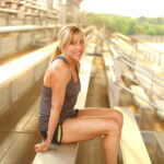 Amee Livingston posed on stadium steps in fitness gear